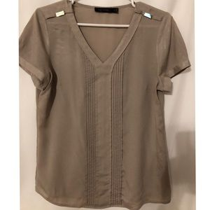 The limited tan blouse size M